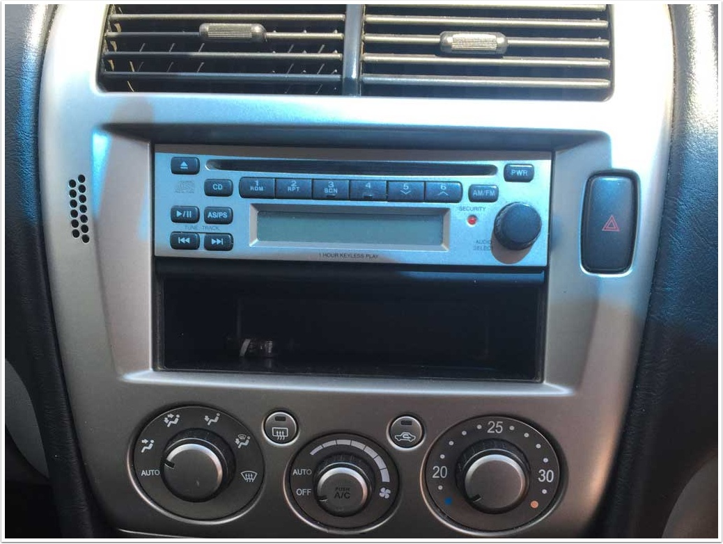 How to remove original car CD player from Mitsubishi Magna ES TL 2004