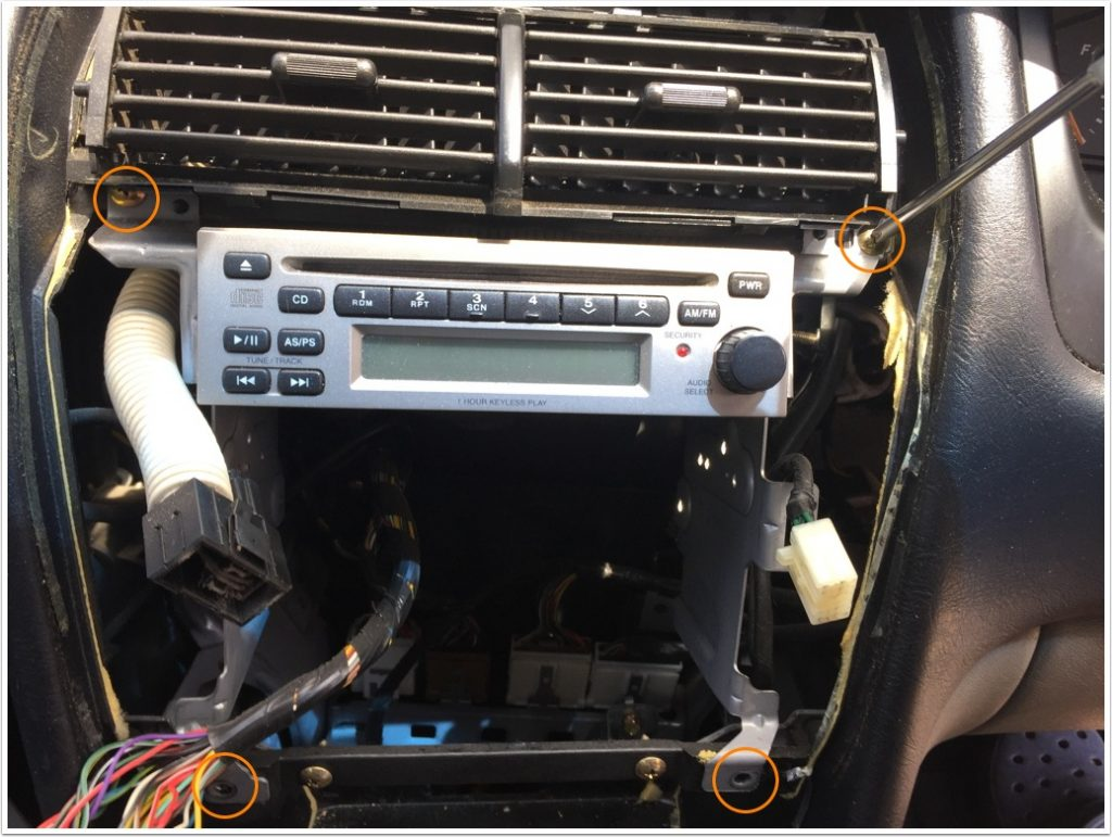 06-remove-the-four-screws-that-hold-the-cd-player-brackets-to-the-dash-with-a-philips-head-screwdrive