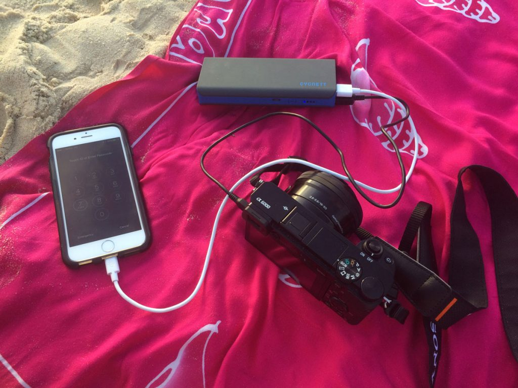 Charging-Sony-A6000-and-iPhone-6-with-powerbank-on-beach-1200