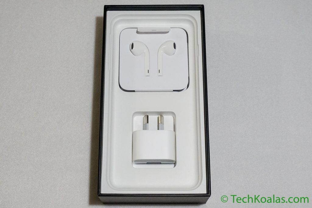 Under the phone you there are the earpods, lightning to headphone jack adapter, lightning to USB cable and a wall charger.