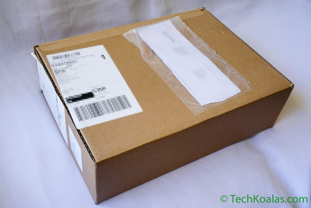 The MacBook Pro was shipped in a cardboard box and arrived in good shape.