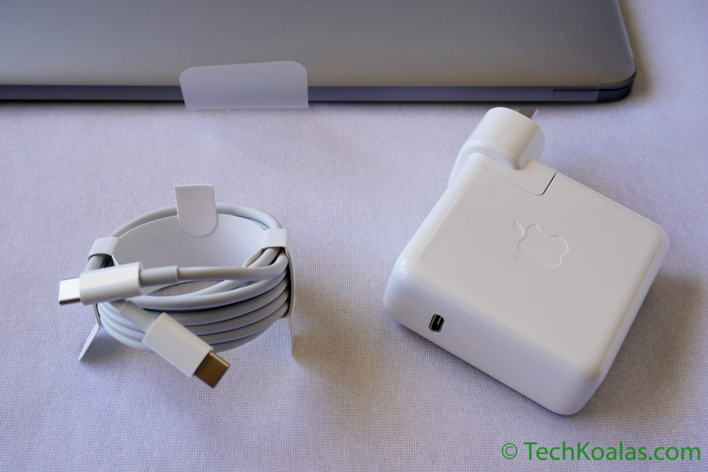 USB Type-C cable and new MacBook Pro wall charger with USB Type-C female connector. The new charger is no longer equiped with flip-out wings to store the cord as on the MagSafe power adaptor.
