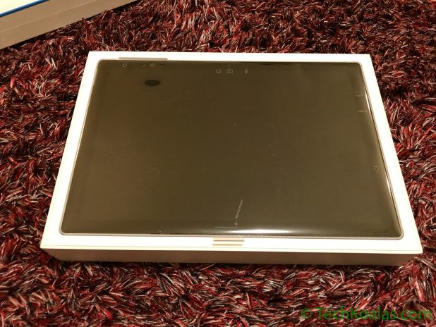 Figure 4. The Microsoft Surface Pro is carefully wrapped and sits flush with the top of the box. Very similar to how the Apple MacBook Pro is set in its box.